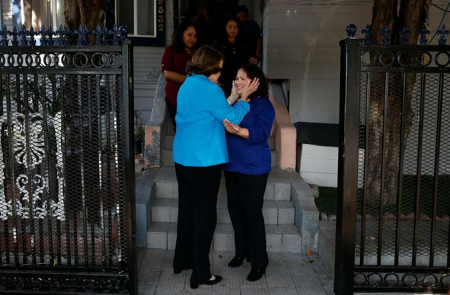 Senator Dianne Feinstein, left, says good bye to Maria Mendoza-Sanchez after meeting with Mendoza-Sanchez and her family at the Sanchez home about their deportation order August 10, 2017 in Oakland, Calif. Photo: Leah Millis, The Chronicle