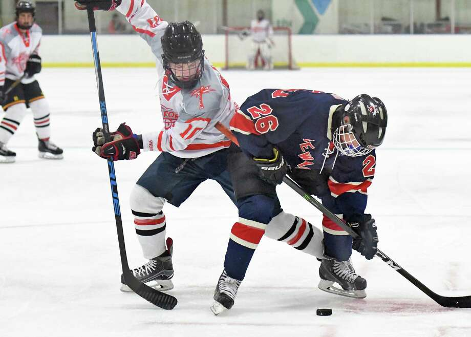 Fort Lauderdale's #10 Jack Cohen, left, and East Hills/ Sid Jacobson's #26 Andrew Cager battle during the Maccabi Games Gold Medal hockey final at the Bethlehem YMCA Thursday August 10, 2017 in Delmar, NY.  (John Carl D'Annibale / Times Union) Photo: John Carl D'Annibale / 20041259A