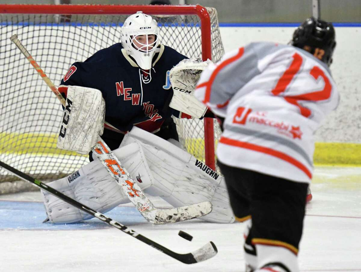 East Hills/ Sid Jacobson' goalie #30 Jake Temkin, left, defends Fort Lauderdale's #1Carson Doyle's shot during the Maccabi Games Gold Medal hockey final at the Bethlehem YMCA Thursday August 10, 2017 in Delmar, NY. (John Carl D'Annibale / Times Union)