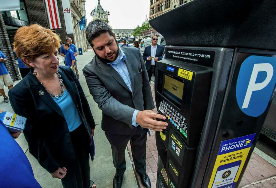 Albany Parking Authority's executive director Matthew Peter  unveils their new parking meters and mobile app to Mayor Kathy Sheehan Monday June 26, 2017 at Albany, N.Y.  (Skip Dickstein/Times Union) Photo: SKIP DICKSTEIN / 20040886A