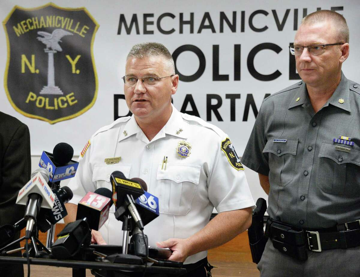 Mechanicville Police Chief Joseph Waldron, left, and NYSP Major Robert Patnaude in August 2017 announcing arrests in the Mechanicville murder on Grove Street. (John Carl D'Annibale / Times Union)