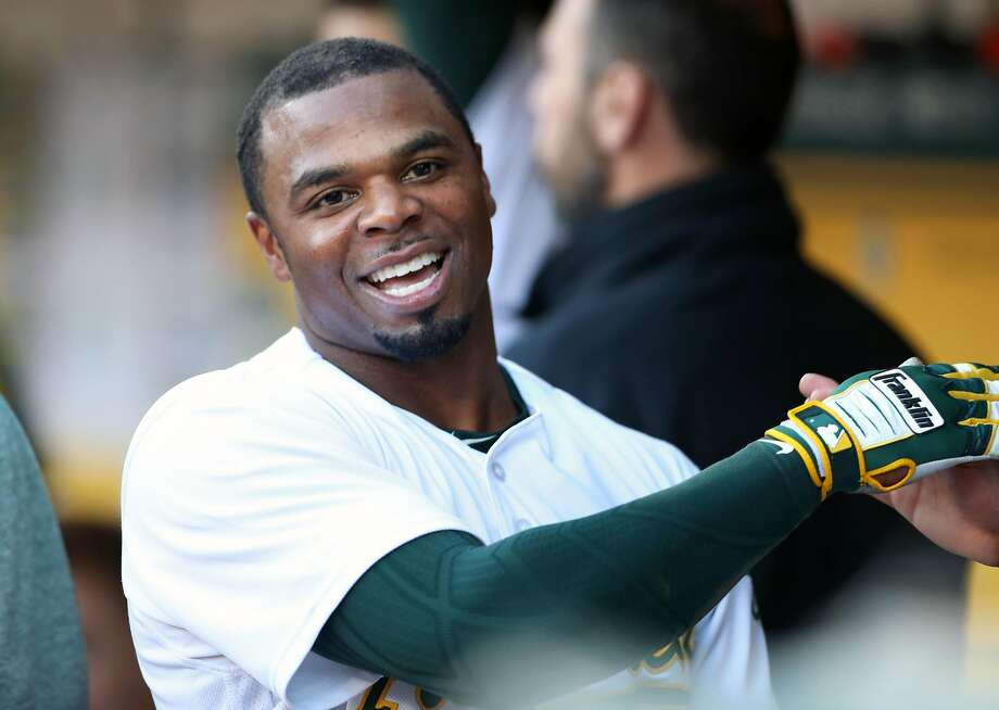 Oakland Athletics' Rajai Davis smiles after scoring on sacrifice fly by Jed Lowrie in 1st inning against Baltimore Orioles during MLB game at Oakland Coliseum in Oakland, Calif. on Thursday, August 10, 2017. Photo: Scott Strazzante, The Chronicle