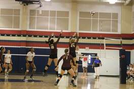 Emma Aillet (10), Hope Hawthorne (24) and Ally Combs (1) watch an attempted block go in the wrong direction during the opening game of the San Antonio O'Connell match Thursday.