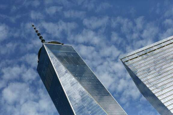 FILE - This Tuesday, Aug. 16, 2016, file photo shows One World Trade Center, left, and 7 World Trade Center, in New York. Technology companies were leading a broad slide in U.S. stocks in early trading Thursday, Aug. 10, 2017, as investors pored over the latest batch of corporate earnings reports. (AP Photo/Mark Lennihan, File)