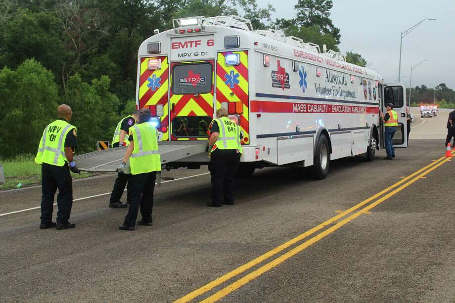Personnel with Atascocita Fire Department set up the ambulance-bus during Wednesday's mass casualty drill in Cleveland. The amb-bus, as it is called, is provided by the Southeast Texas Regional Advisory Council, according to Cleveland ISD Police Chief Rex Evans. Photo: Vanesa Brashier