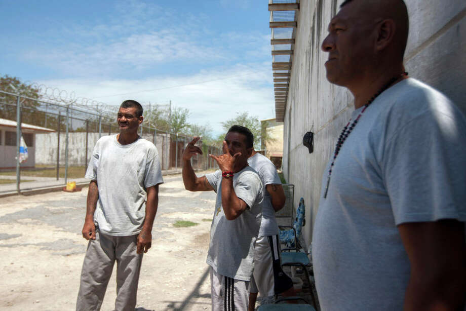 Inmates seen in the prison in Reynosa, Tamaulipas state, Mexico during a visit by journalists on May 24, 2017. Two weeks ago, authorities found a tunnel and weapons buried inside the overcrowded prison in Reynosa, where 80 percent of the inmates belong to the Gulf Cartel.  / AFP PHOTO / Julio Cesar AGUILAR        (Photo credit should read JULIO CESAR AGUILAR/AFP/Getty Images) Photo: JULIO CESAR AGUILAR/AFP/Getty Images