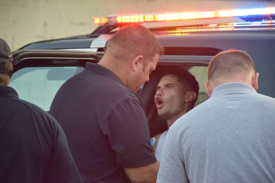 Police on Friday arrested a man after he led them on a chase that began on the North Side and ended in the South. Photo: Caleb Downs / San Antonio Express-News