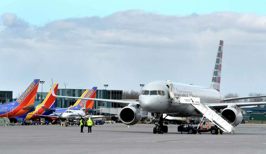 An American Airlines flight from Madrid, Spain sits on the tarmac at Albany International Airport after being diverted from Laguardia Airport due to weather conditions downstate  Friday  March 10, 2017 in Colonie, N.Y. Seven other flights had to be diverted due to poor weather conditions elsewhere in the country. (Skip Dickstein/Times Union) Photo: SKIP DICKSTEIN