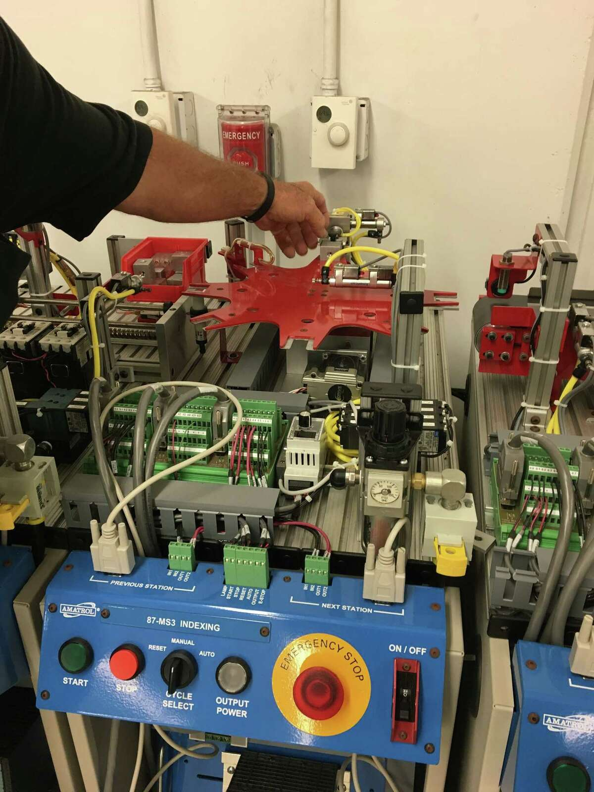 Mike Branchteaches mechatronics and students learn electronics, pneumatics, hydraulics, motors, computer controls, and heating and air-conditioning equipment.