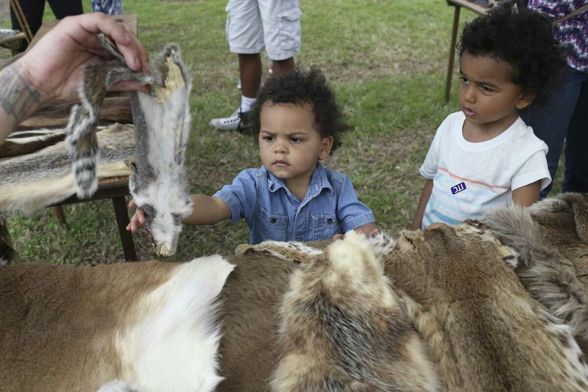 Porter Cervantes (left), 2, and brother Henry, 4, check out a squirrel hide during Buffalo Soldier Day this year at the San Antonio Institute of Texan Cultures. A reader describes the value of the institute.