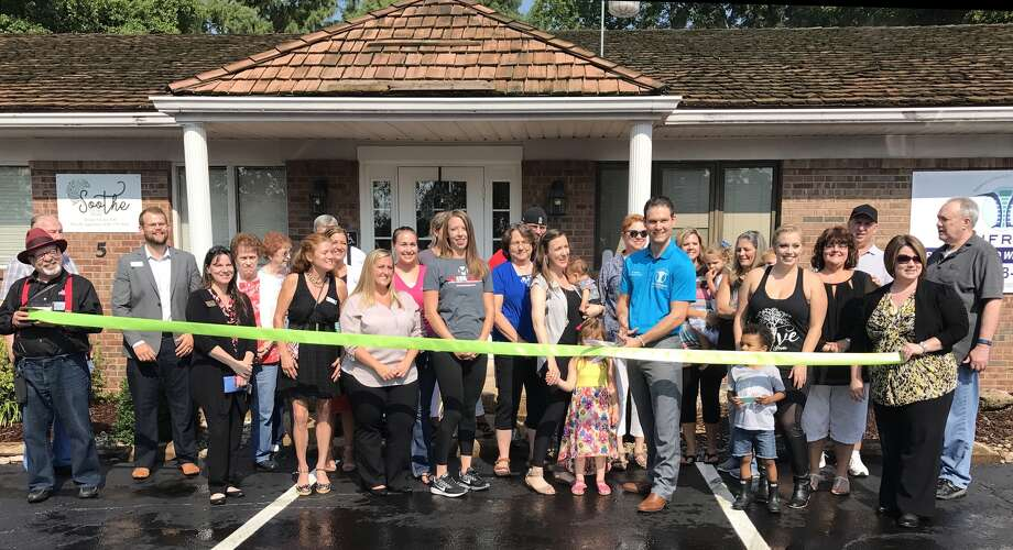 Unfried Chiropractic and Wellness Center hosted an official ribbon cutting ceremony at 4 p.m., Thursday, Aug. 10. Owner Andrew Unfried celebrated with family, friends, local business owners and members of the Edwardsville/ Glen Carbon Chamber of Commerce. The center is officially open for business. Photo: Cody King • Cking@edwpub.net