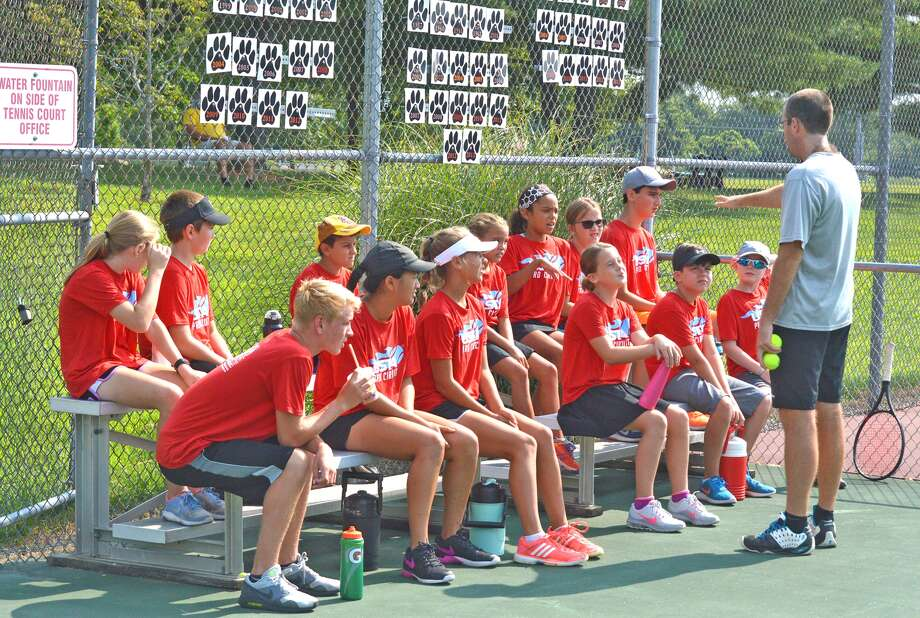 Kirk Schlueter, far right, gives instructions to the ball kids for the USTA Edwardsville Futures tournament, which will run through Sunday at the EHS Tennis Center.