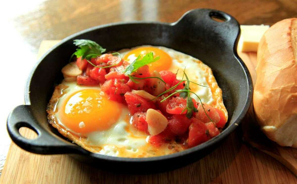 The Huevos con Tomate (two baked eggs topped with peeled tomatoes, garlic and olive oil, served with french baguette and butter) at Andes Café.Click here for Culinary Stars tickets!