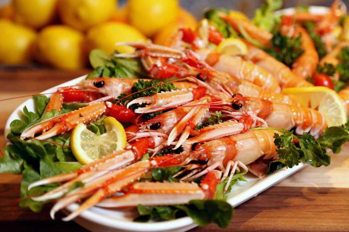 Sicilian lobster scampi, marinated with sea salt, olive oil, chives, citrus pink pepper and candid tomatoes at Amalfi Click here for Culinary Stars tickets!