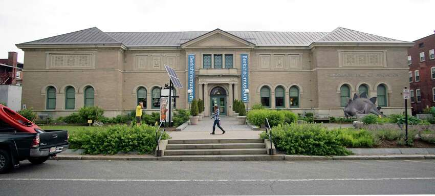 In this Wednesday, July 12, 2017 photo, a pedestrian walks past the Berkshire Museum in Pittsfield, Mass. The museum has come under intense national and local pressure after announcing that it is selling 40 works of art, including two by Normal Rockwell, the illustrator who called the region home for the last 30-plus years of his life. (Ben Garver/The Berkshire Eagle via AP)
