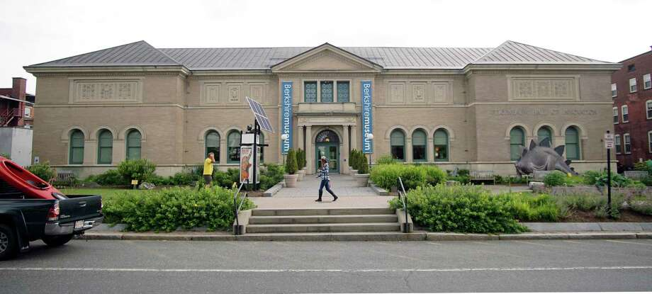 In this Wednesday, July 12, 2017 photo, a pedestrian walks past the Berkshire Museum in Pittsfield, Mass. The museum has come under intense national and local pressure after announcing that it is selling 40 works of art, including two by Normal Rockwell, the illustrator who called the region home for the last 30-plus years of his life. (Ben Garver/The Berkshire Eagle via AP) Photo: Ben Garver / The Berkshire Eagle