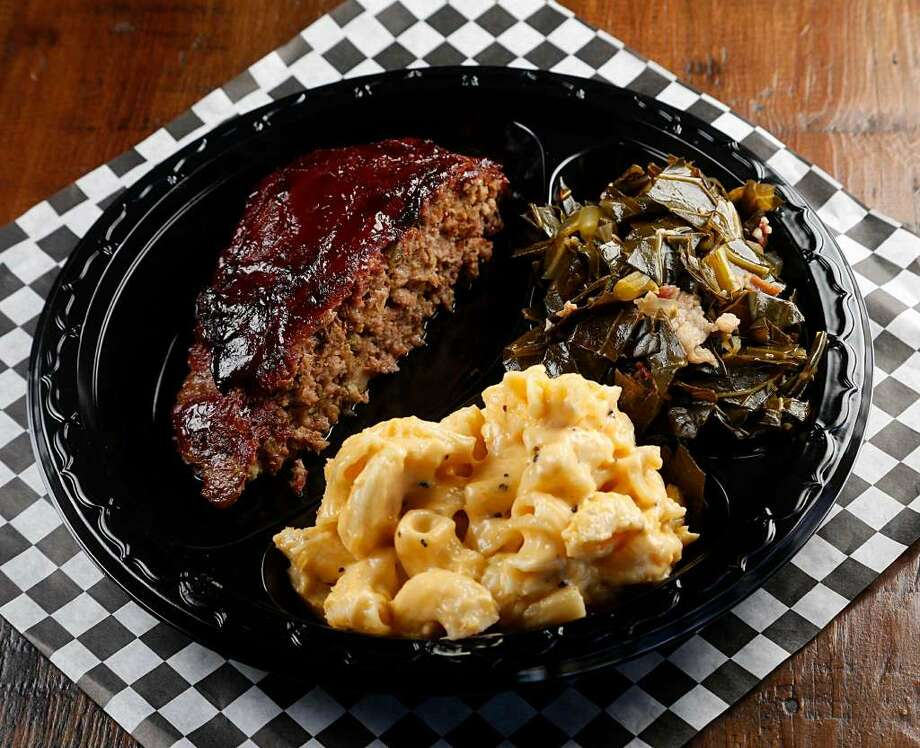 Pappa Charlies serves bacon-wrapped smoked meatloaf, mac and cheese and collard greens. Photo: Houston Chronicle