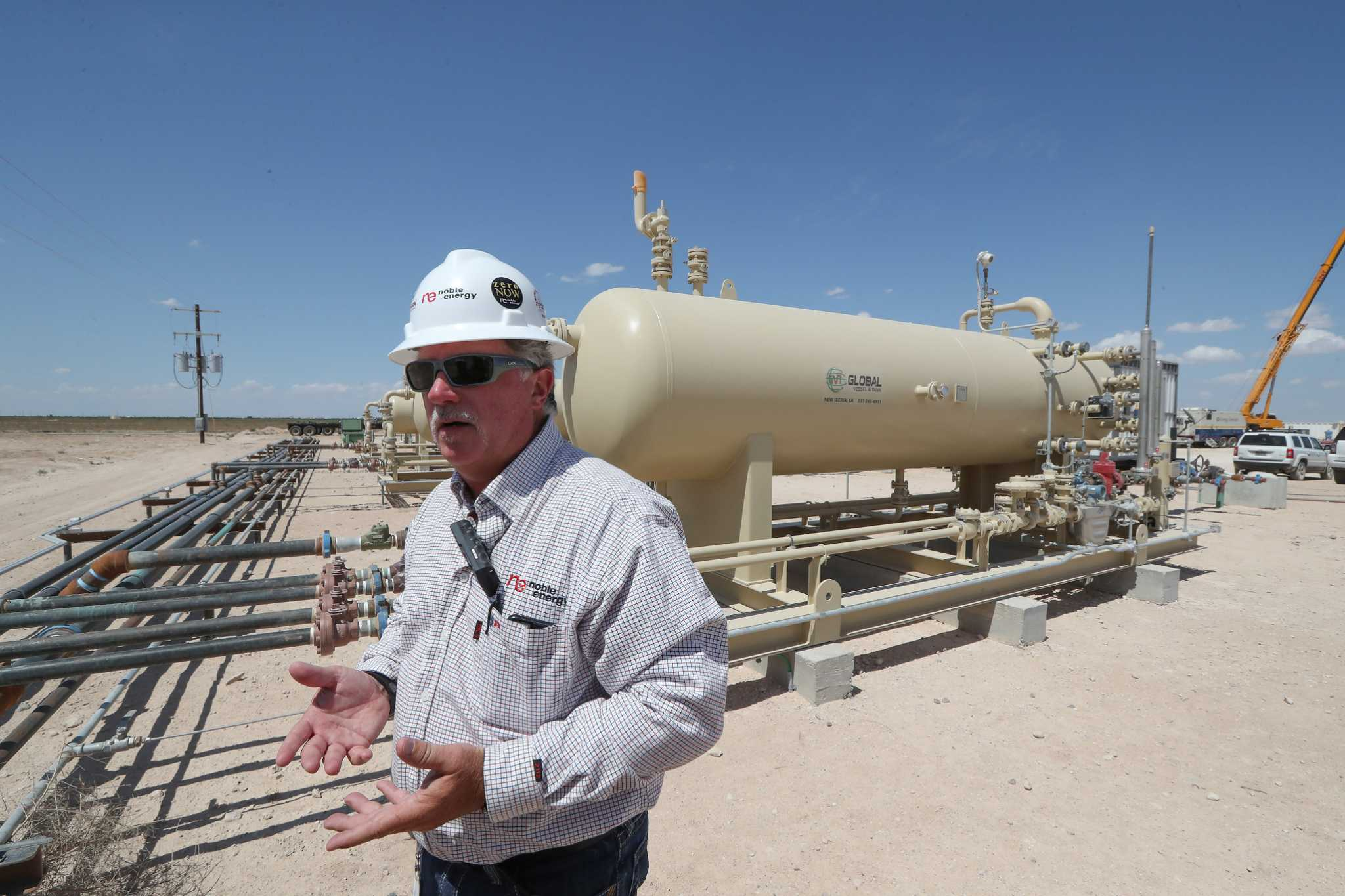 Noble Energy posts loss, cuts spending