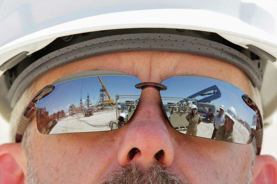 Noble Energy's Donnie Moore views their fracking site Monday, June 26, 2017, in Pecos, TX. ( Steve Gonzales  / Houston Chronicle ) Photo: Steve Gonzales, Staff / © 2017 Houston Chronicle