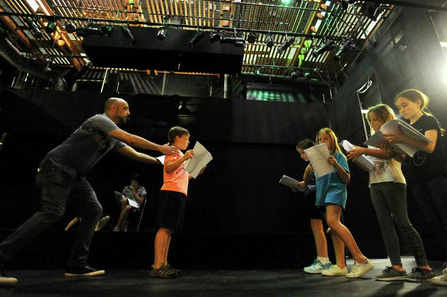 Acting and improvisation instructor Anthony Republicano, left, helps Mateus Witczak correctly position himself while practicing a scene from The Wizard of Oz during Curtain Call's Summerstock Junior program inside the Kweskin Theatre in Stamford, Conn. on Thursday, August 10, 2017. Photo: Michael Cummo / Hearst Connecticut Media / Stamford Advocate