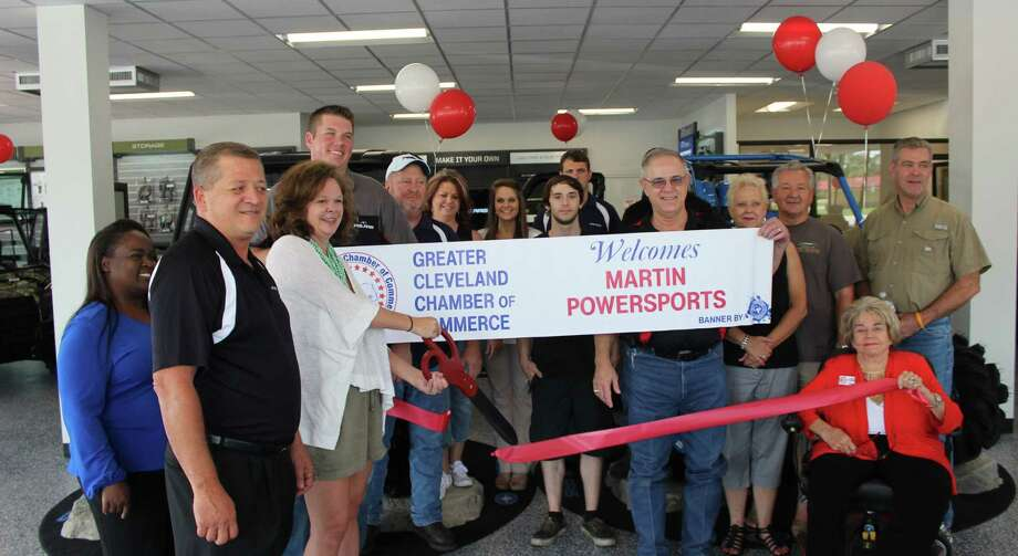 Janet Martin cuts the ribbon welcoming Martin Powersports into the Greater Cleveland Chamber of Commerce on Aug. 5. Photo: Jacob McAdams