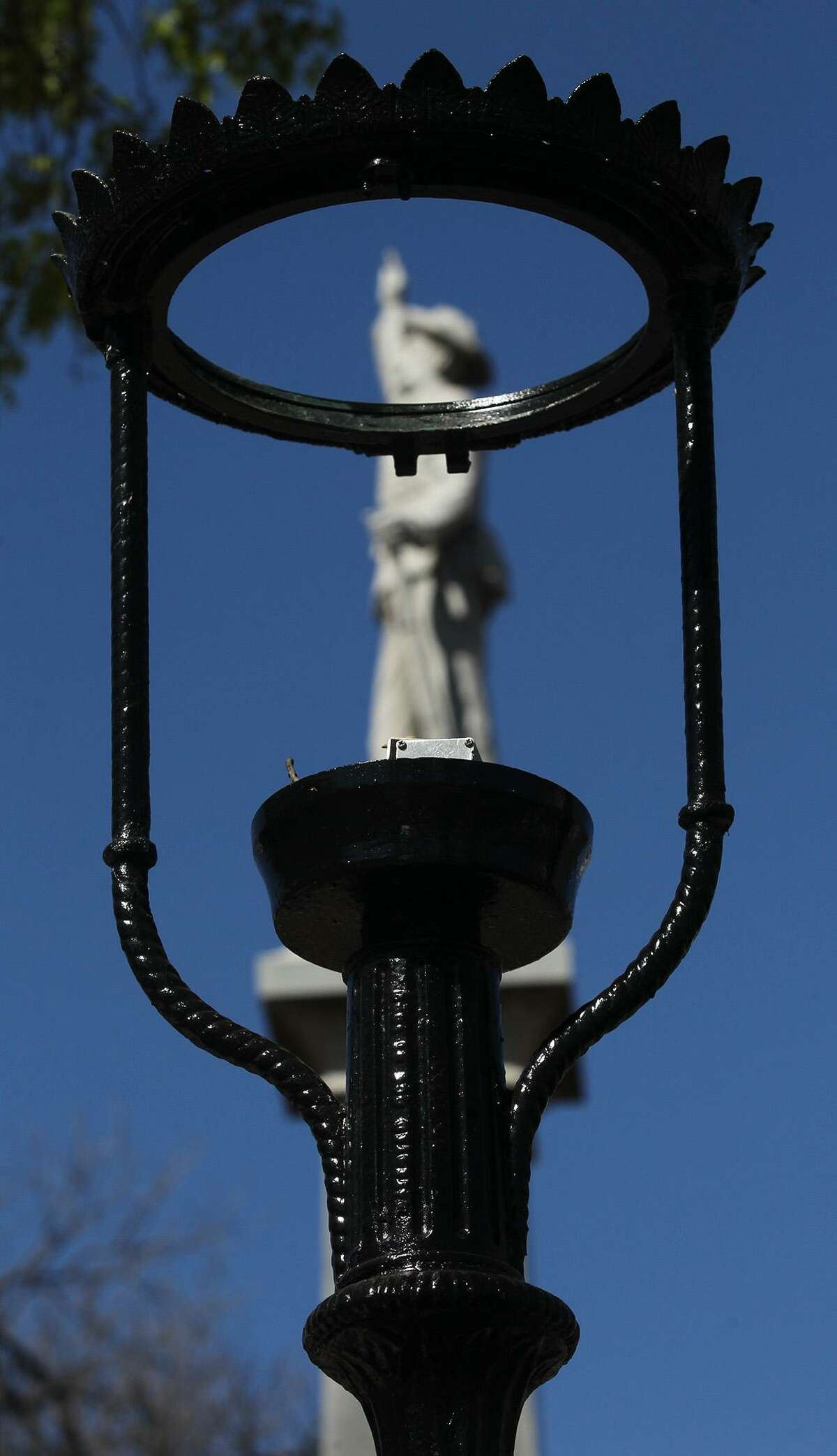 A revamped lamp and post stands by the monument to the Confederate War Dead at Travis Park March 17, 2014.