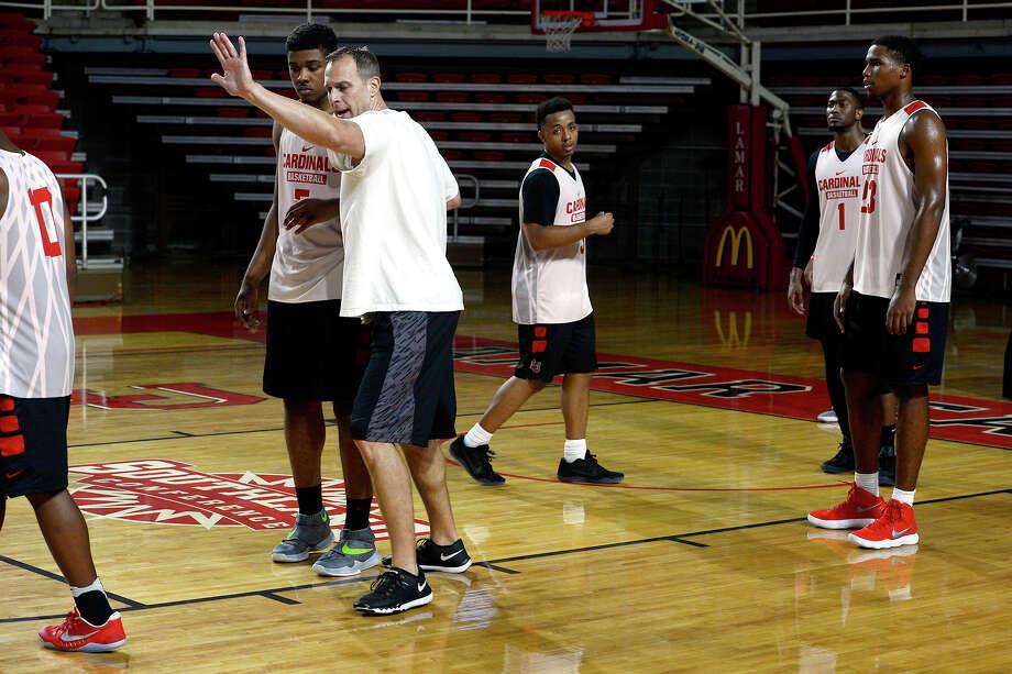 Lamar men's basketball associate head coach Bobby Kummer talks to players during practice on Thursday.  Photo taken Thursday 8/10/17 Ryan Pelham/The Enterprise Photo: Ryan Pelham / ©2017 The Beaumont Enterprise/Ryan Pelham