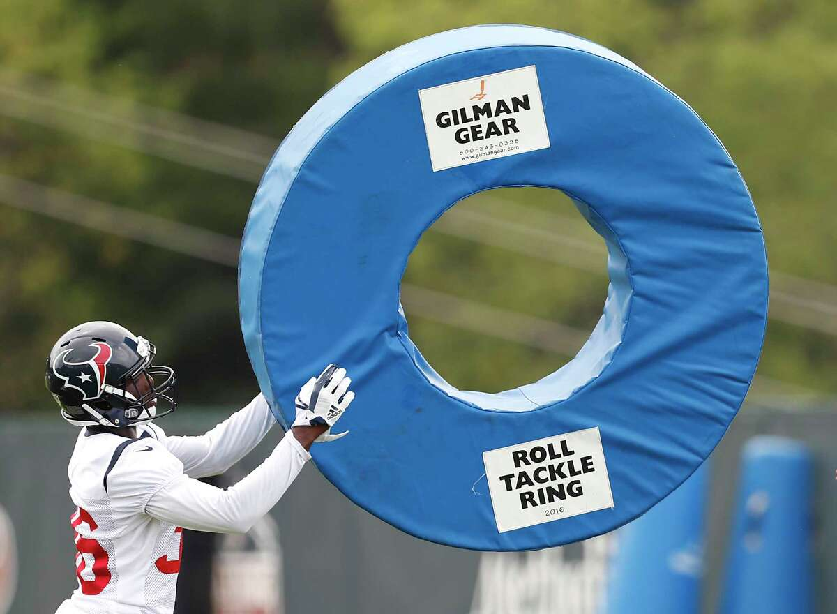 Houston Texans cornerback Malik Smith (36) hits a tackling ring during training camp at The Greenbrier on Friday, Aug. 11, 2017, in White Sulphur Springs, W.Va.