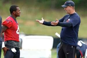 Houston Texans head coach Bill O'Brien, right, talks to quarterback Deshaun Watson (4) during training camp at The Greenbrier on Friday, Aug. 11, 2017, in White Sulphur Springs, W.Va.