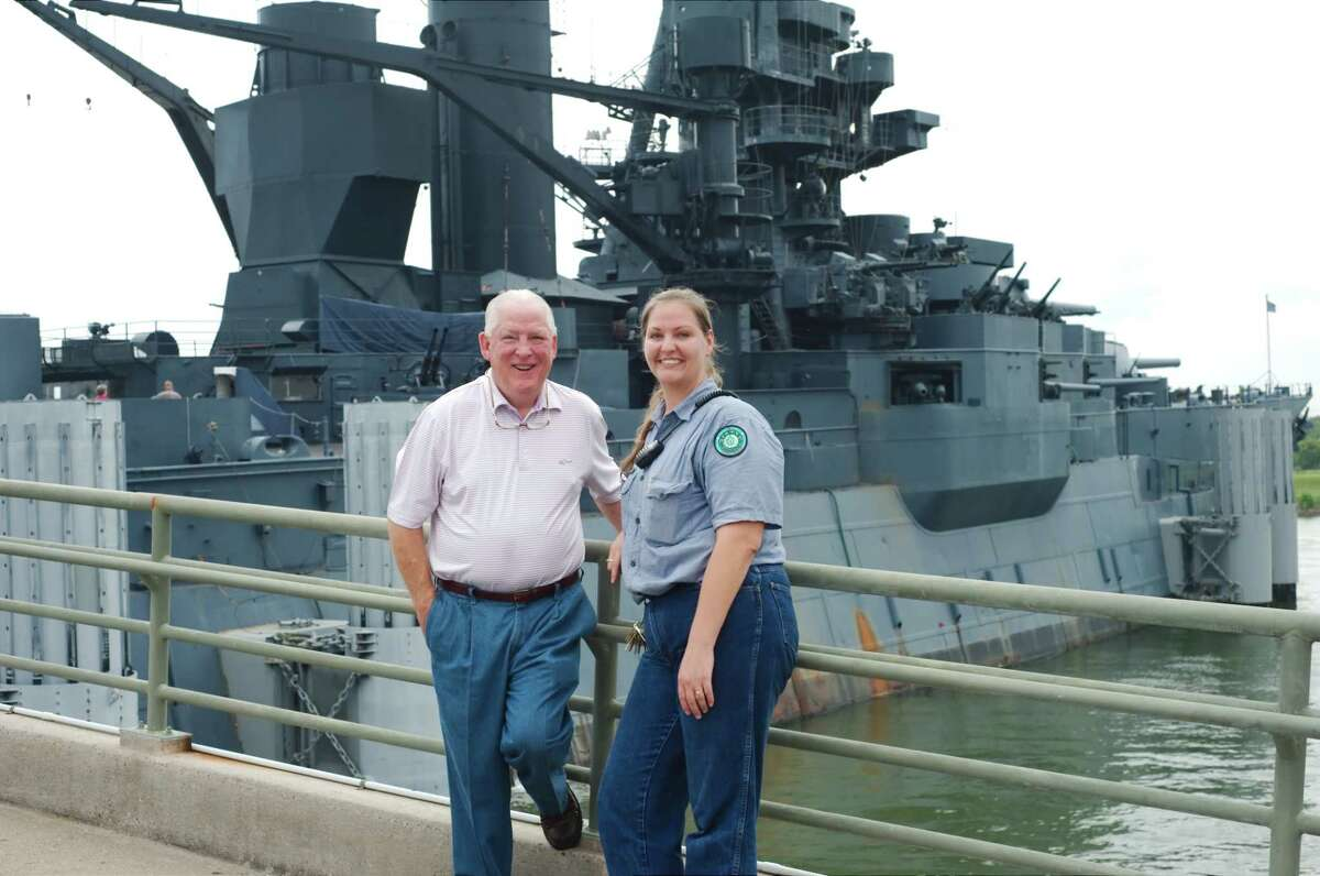 Stephanie Croatt, assistant superintendent with the Battleship Texas, and Bruce Bramlett, executive director of the Battleship Texas Foundation, stand on the deck of the World War I-era ship, which is deteriorating.