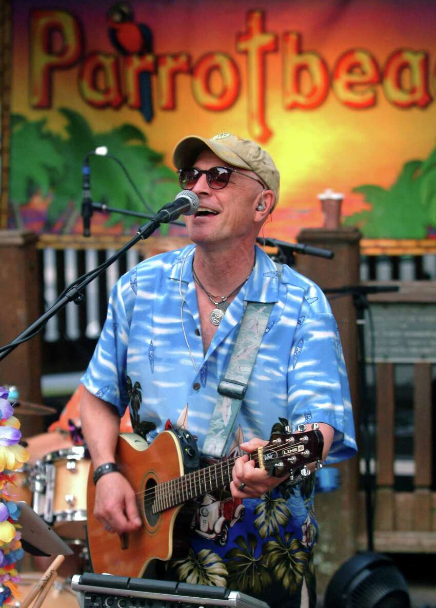 Remy St. Martin, with the Jimmy Buffet tribute band Parrotbeach, performs during Shelton Parks and Recreation's 2017 Music Under the Stars concert series on Huntington Green in Shelton, Conn. on Wednesday August 9, 2017. The next concert is August 16 - Terrapin Grateful Dead from 7 p.m. to 9 p.m..