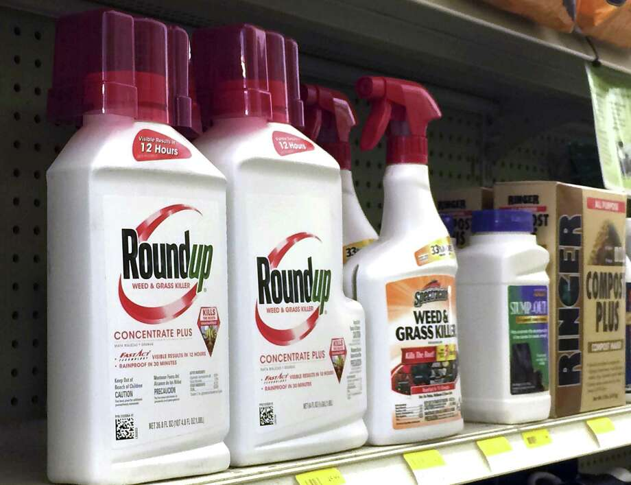 In this Thursday, Jan. 26, 2017, photo, containers of Roundup, left, a weed killer is seen on a shelf with other products for sale at a hardware store in Los Angeles. Glyphosate, the active ingredient in Roundup, is a suspected carcinogen. As the federal government renews tests to determine how much glyphosate is in America's foods, Connecticut environmental groups, organic farmers and a U.S. senator say it's time to limit the use of, or ban, the popular herbicide. (AP Photo/Reed Saxon) Photo: Reed Saxon / Associated Press / Copyright 2017 The Associated Press. All rights reserved.