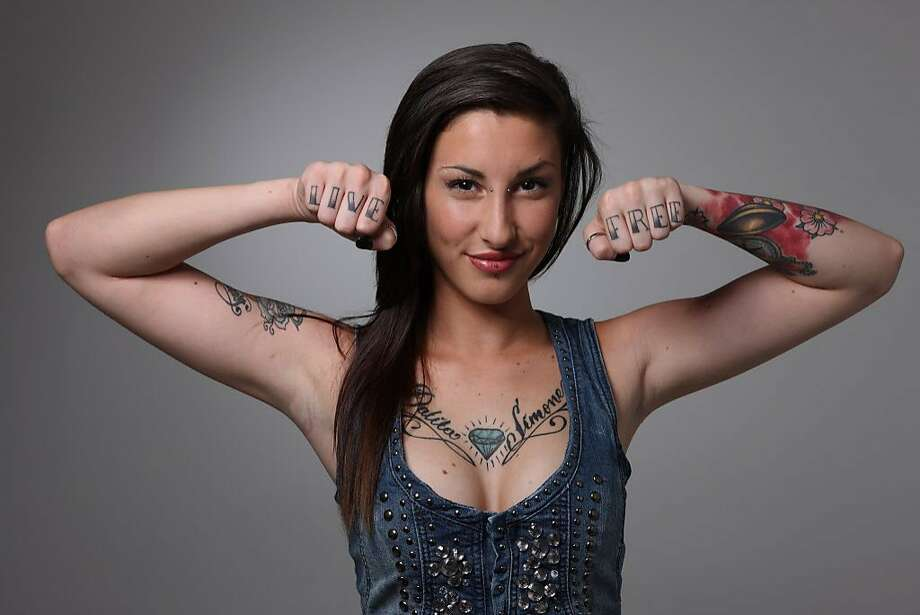 A mom is worried that her daughter will be influenced by her dad to get tattoos. Photo: Vincenzo Lombardo, Getty Images