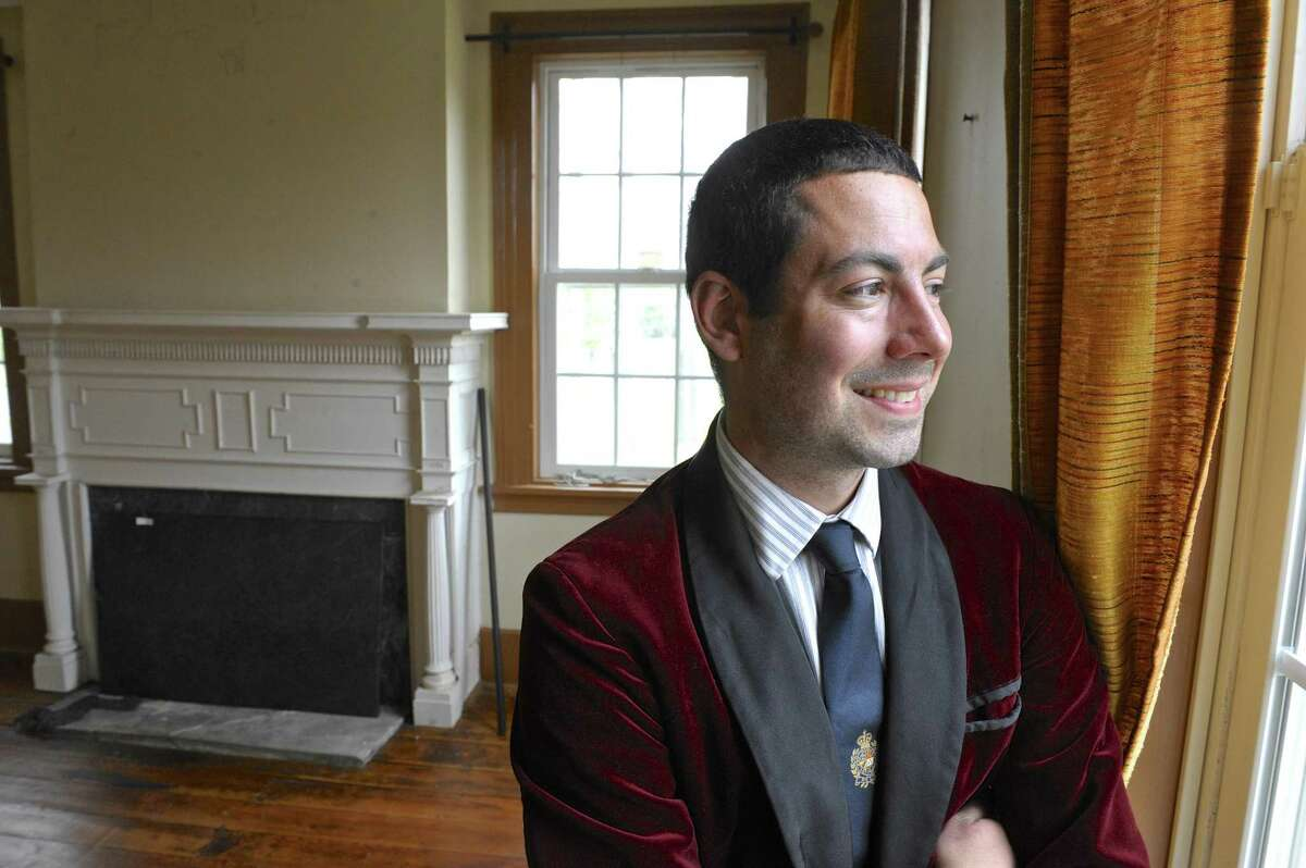 """Justin Krul stands inside what he hopes will be the new location of his store """"Just In Antiques & More"""" on Danbury Road in New Milford. The building, a home built in the 1800's, is on the national historic landmark registry, but has sat vacant for a number of years. Friday, April 29, 2016, in New Milford, Conn."""