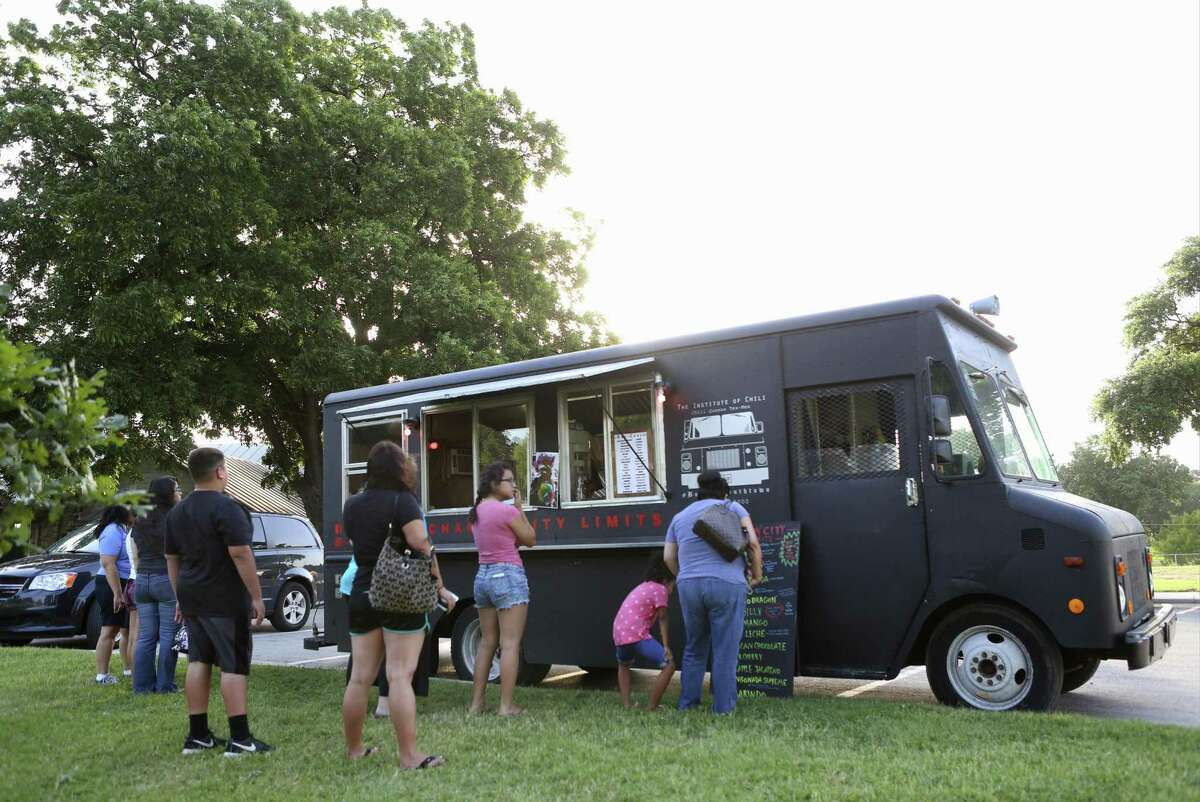 Customers line up at the Chamoy City Limits food truck at Lion's Field Park in San Antonio.