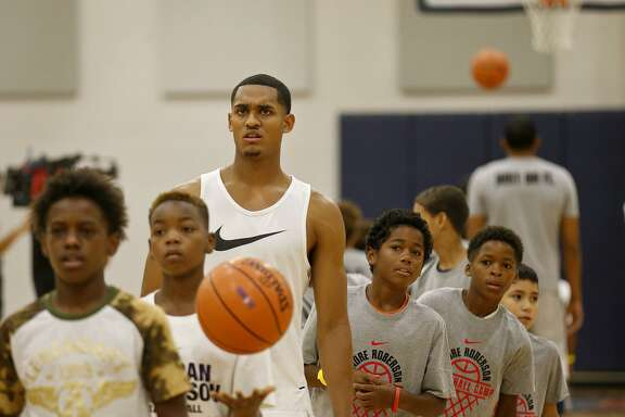 Los Angeles Lakers' Jordan Clarkson shoots baskets during a dual basketball clinic with the Oklahoma City Thunder's Andre Roberson on Aug. 4, 2017 at Veterans Memorial High School in San Antonio.