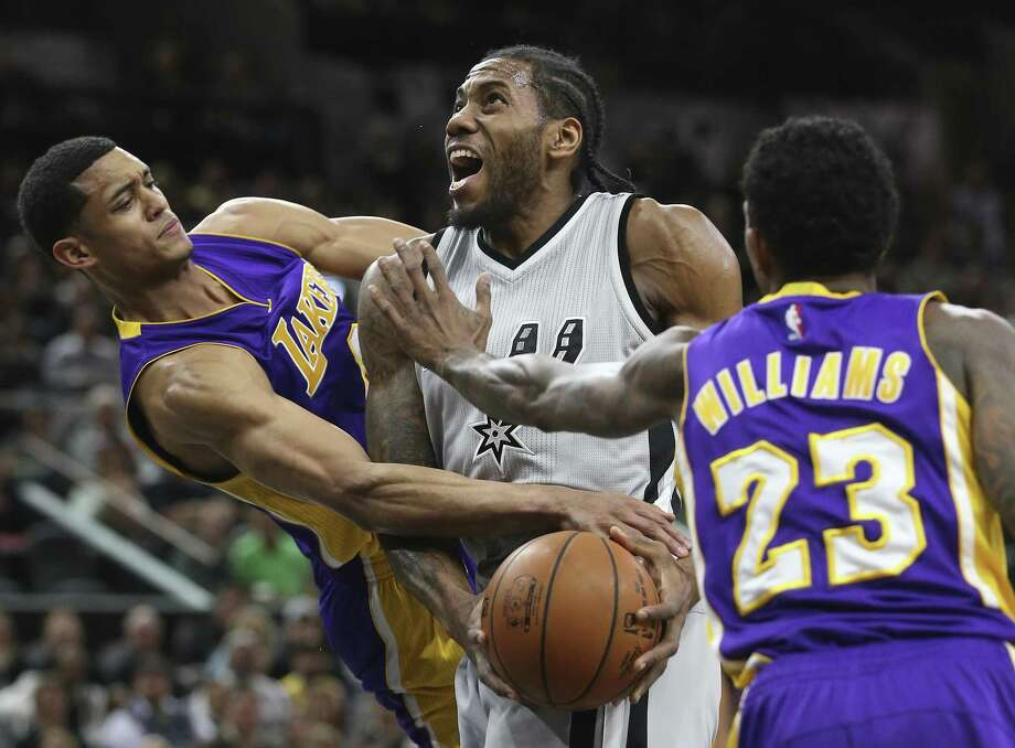 Kawhi Leonard gets fouled by Jordan Clarkson (left) under the hoop as the Spurs host the Lakers at the AT&T Center on Feb. 6, 2016. Photo: Tom Reel /San Antonio Express-News / 2016 SAN ANTONIO EXPRESS-NEWS