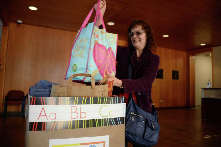 """'I think that anyone who can afford school supplies should help,"""" said Debi Fairchild, who recently dropped off two bags of supplies at City Hall as part of a local drive. """"It's just like food, it's something that is needed."""" Photo: Courtesy Photo"""