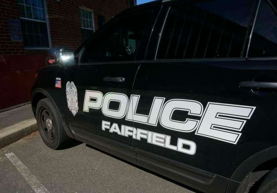 Fairfield police came to the rescure after an infant was accidentally locked inside a car Thursday. Photo: File Photo / File Photo / Fairfield Citizen