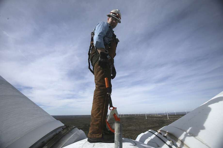 Randy Adams hangs off the hub of a prop of a wind turbine at the Desert Sky Wind Farm Jan. 10, 2017, hundreds of feet above the West Texas plains near Iraan, Texas. Adams was performing maintenance on one of the many aging wind turbines that supply power to CPS Energy. Photo: John Davenport /San Antonio Express-News / ©San Antonio Express-News/John Davenport