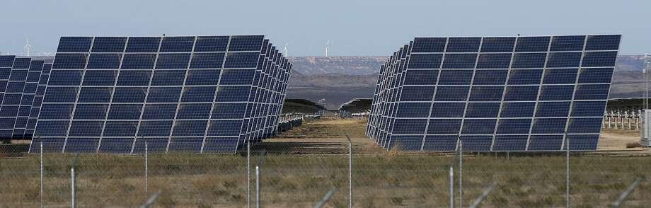 These solar panels are part of the 110-megawatt Alamo 6 solar power plant built by San Antonio-based OCI Solar Power in Pecos County. Photo: John Davenport /San Antonio Express-News / ©John Davenport/San Antonio Express-News