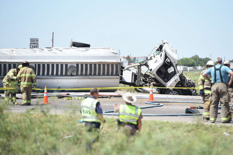 Midland County emergency responders work a scene involving a rolled tanker trailer leaking fluid onto the road near the intersection of County Road 60 and State Highway 349 on Aug. 11, 2017. James Durbin/Reporter-Telegram Photo: James Durbin