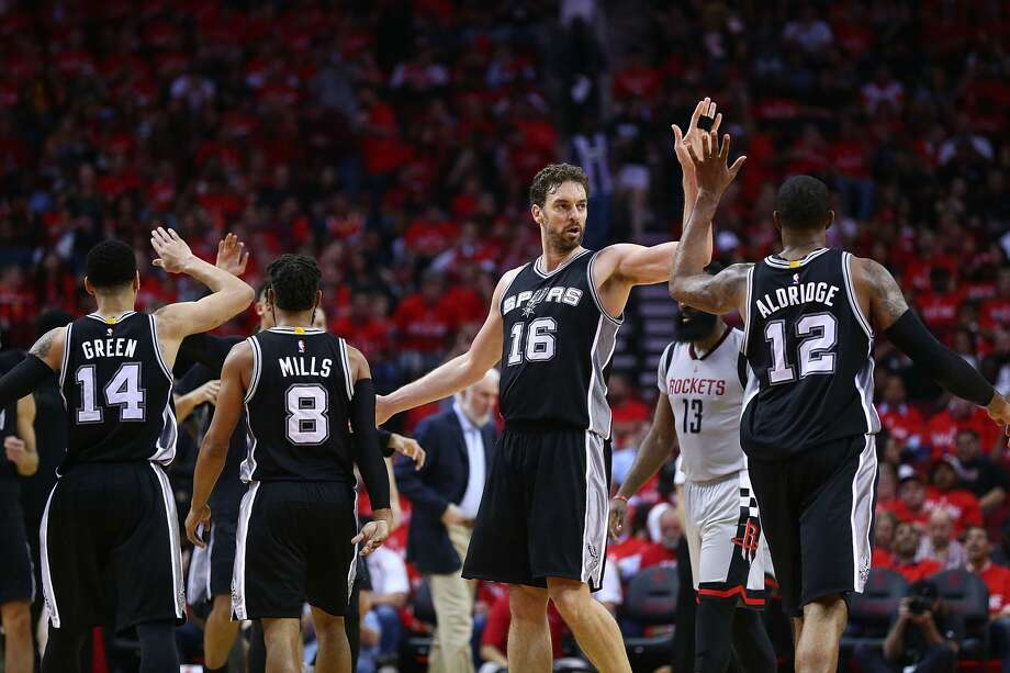 HOUSTON, TX - MAY 11:  Pau Gasol #16 of the San Antonio Spurs reacts with Danny Green #14, Patty Mills #8 and LaMarcus Aldridge #12 against the Houston Rockets during Game Six of the NBA Western Conference Semi-Finals at Toyota Center on May 11, 2017 in Houston, Texas.  NOTE TO USER: User expressly acknowledges and agrees that, by downloading and or using this photograph, User is consenting to the terms and conditions of the Getty Images License Agreement.  (Photo by Ronald Martinez/Getty Images) Photo: Ronald Martinez/Getty Images