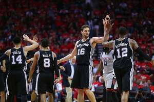 HOUSTON, TX - MAY 11:  Pau Gasol #16 of the San Antonio Spurs reacts with Danny Green #14, Patty Mills #8 and LaMarcus Aldridge #12 against the Houston Rockets during Game Six of the NBA Western Conference Semi-Finals at Toyota Center on May 11, 2017 in Houston, Texas.  NOTE TO USER: User expressly acknowledges and agrees that, by downloading and or using this photograph, User is consenting to the terms and conditions of the Getty Images License Agreement.  (Photo by Ronald Martinez/Getty Images)