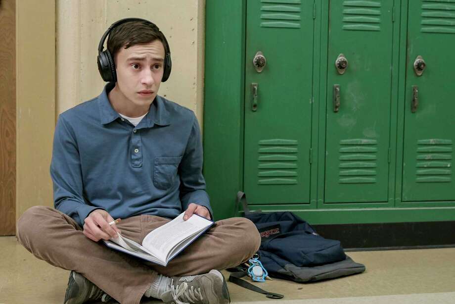 "Sam (Keir Gilchrist), who has high-functioning autism, wants a girlfriend but struggles to navigate the social aspects of high school, taking notes on his ""research,"" in ""Atypical,"" a new Netflix series. Photo: Netflix"