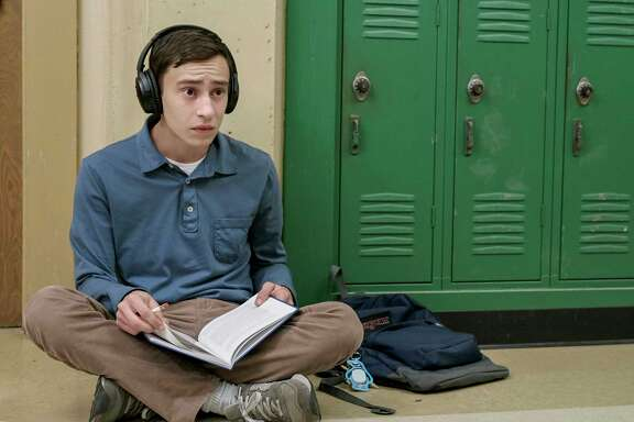 "Sam (Keir Gilchrist), who has high-functioning autism, wants a girlfriend but struggles to navigate the social aspects of high school, taking notes on his ""research,"" in ""Atypical,"" a new Netflix series."