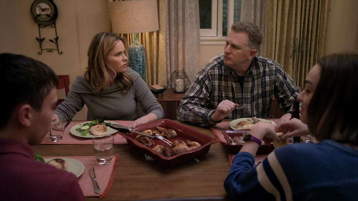 """""""Atypical"""" stars Jennifer Jason Leigh and Michael Rapaport, center, as Elsa and Doug, the parents of Sam (Keir Gilchrist) and Casey (Brigette Lundy-Paine)."""