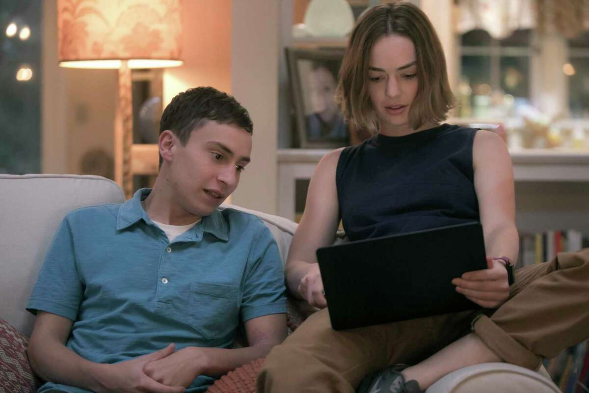 """Sam (Keir Gilchrist), who has high-functioning autism, wants a girlfriend but struggles to navigate the social aspects of high school, taking notes on his """"research,"""" in """"Atypical,"""" a new Netflix series."""