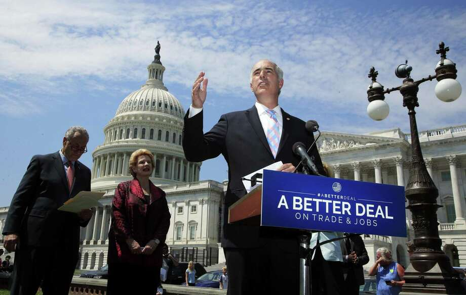 """Sen. Bob Casey, D-Pa., with Sen. Debbie Stabenow, D-Mich., unveils """"A Better Deal On Trade and Jobs"""" on Aug. 2 However, it contains a $15 minimum wage, which would spell fewer jobs. Photo: Manuel Balce Ceneta /Associated Press / Copyright 2017 The Associated Press. All rights reserved."""