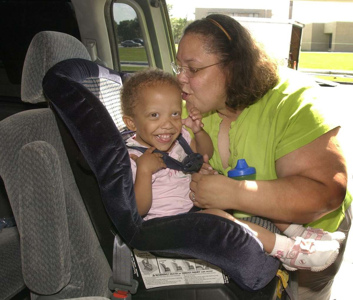 Amy Denton picks up her daughter Elaina 3, from Agape Christian Preschool in Pasadena in 2005. Harris County Protective Services was kicking off a campaign to inform parents about the dangers of leaving their babies in hot cars. The problem persists.